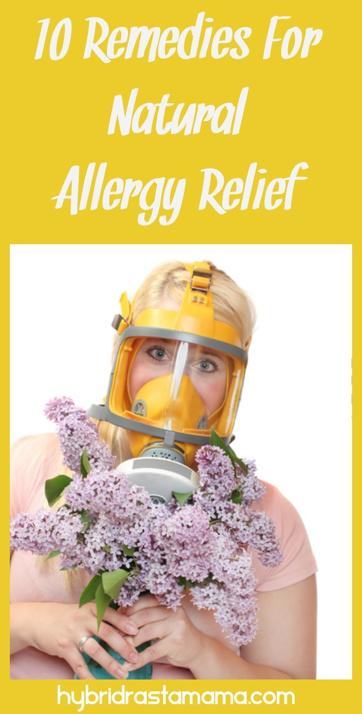 Natural allergy relief - woman holding purple flowers wearing a gas mask