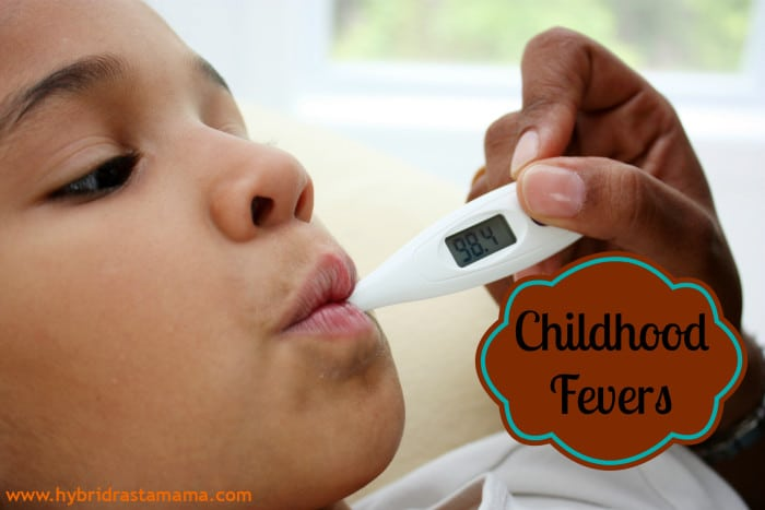 Young african american child getting temperature taken to see if she has a fever