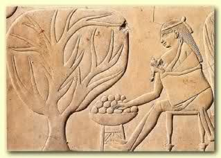 A hieroglyphic of a woman wearing a baby