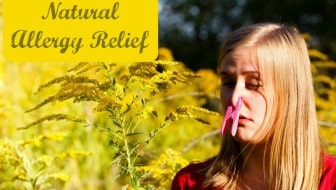 Natural Allergy Relief - woman in a field of pollen with her nose plugged with a clothespin