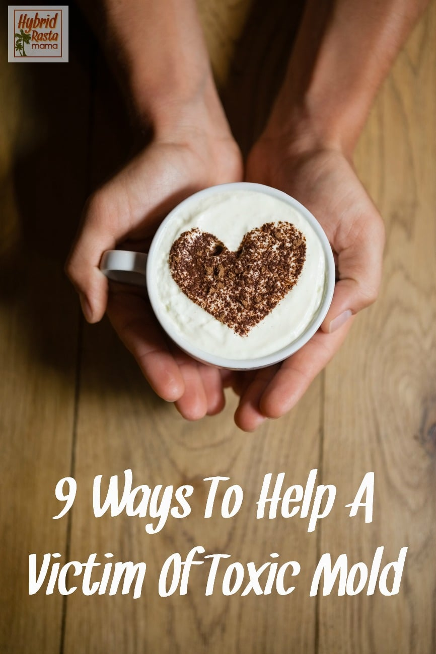 two hands holding coffee cup with froth and heart