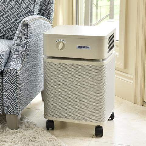 Austin Air Purifier on casters in a living room