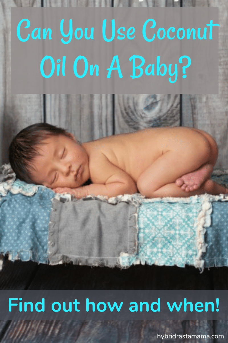 A baby sleeping on a small bed dreaming about whether or not you can use coconut oil on a baby.