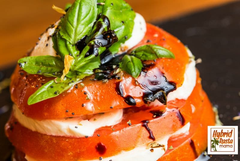 A simple, delicious Caprese Salad that takes seconds to whip together. It tastes like a million bucks. Grab the recipe from HybridRastaMama.com