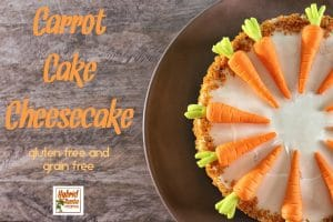 Brown plate with delicious carrot cake cheesecake on wooden background
