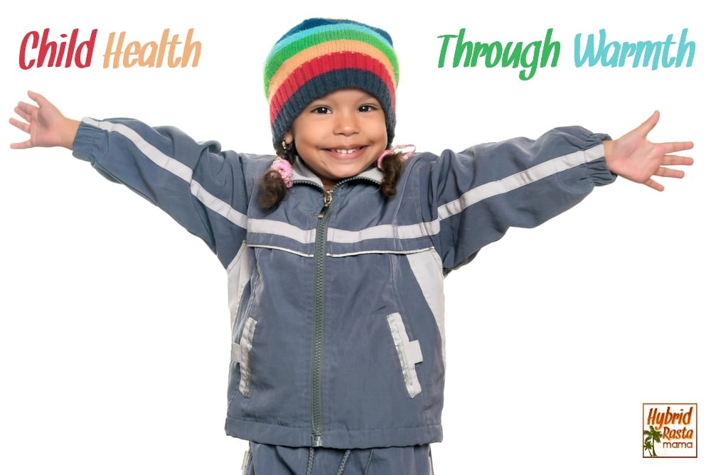 Child health through warmth - young mixed raced girl dressed in layers and a warm beanie
