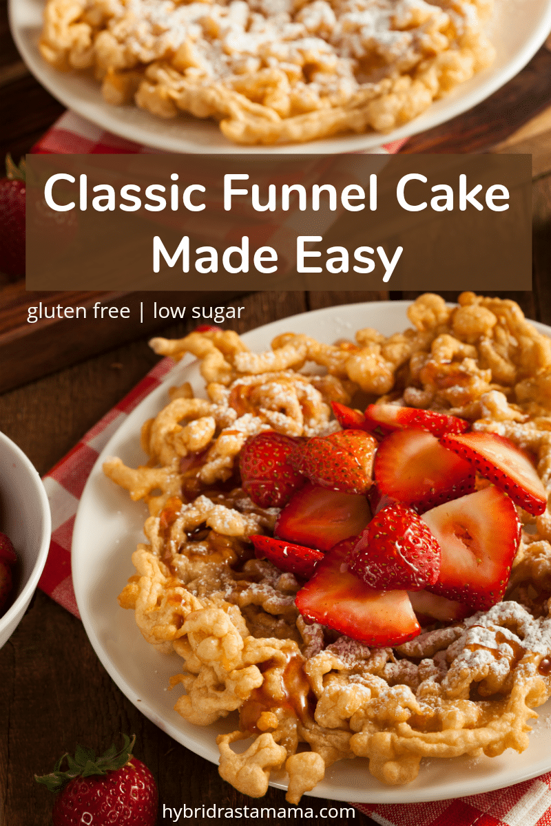 Carnival style gluten free funnel cake topped with powdered sugar and strawberries
