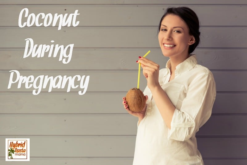 A woman drinking coconut water during pregnancy right out of a coconut