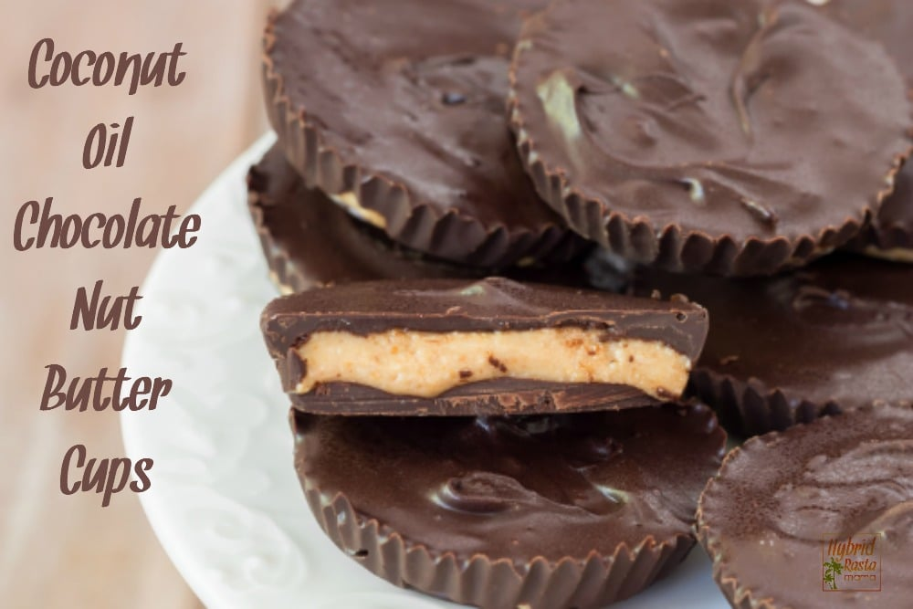 Coconut oil nut butter cups on a white plate with light tan background