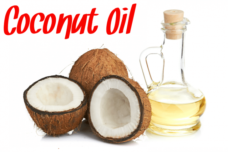 A jar of coconut oil next to coconuts