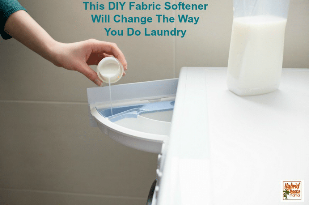 A hand pouring DIY fabric softener into the washing machine