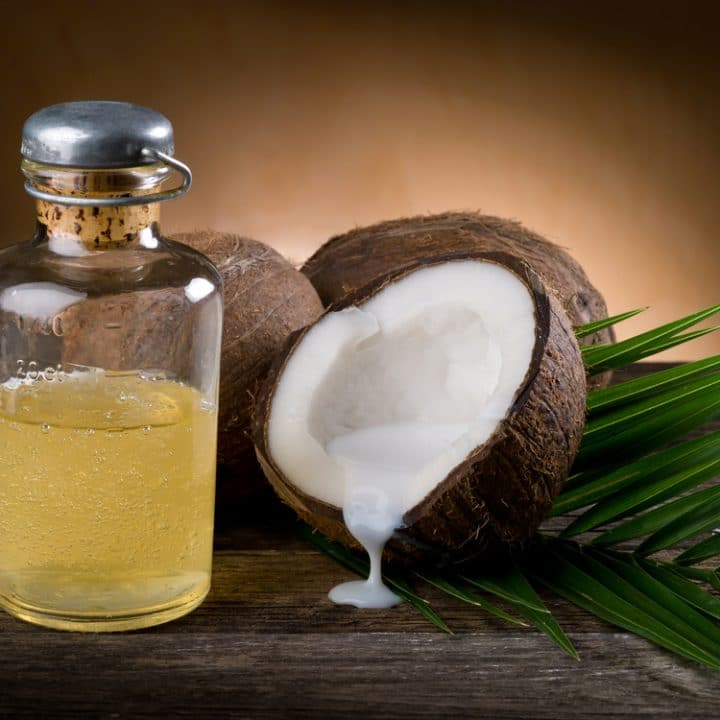 Coconut oil face wash for acne with a coconut open in the background