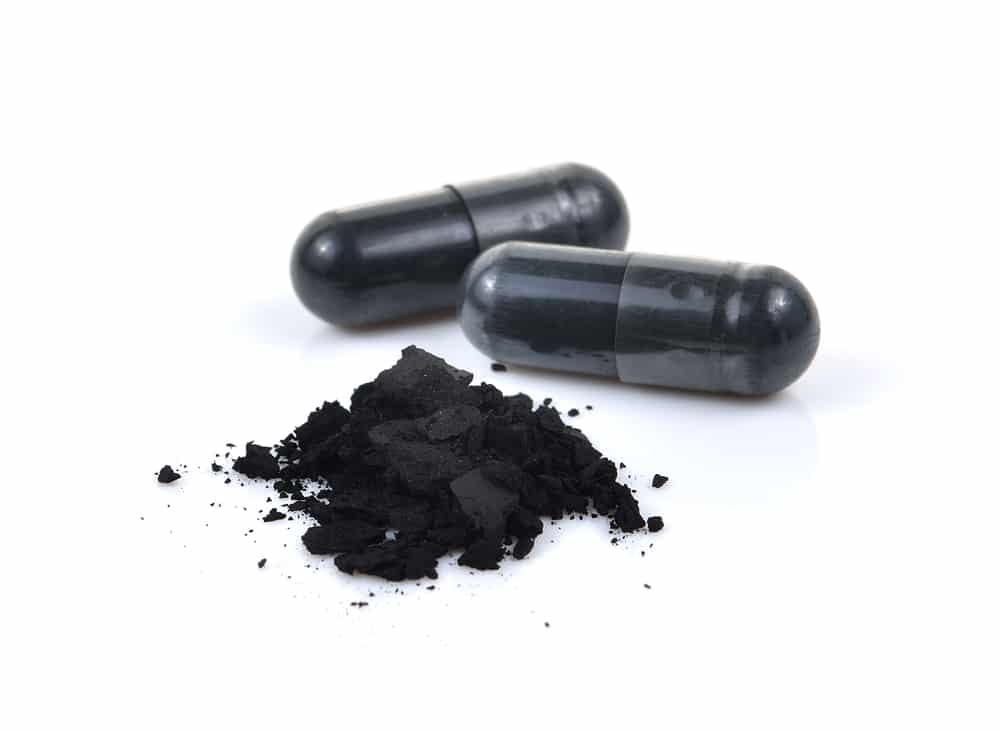 Activated Charcoal capsules isolated on white background