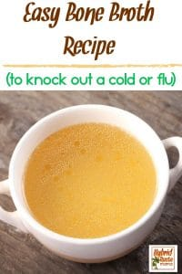 "A cup of bone broth on a wood background with the caption ""easy bone broth recipe to knock out a cold or flu."""