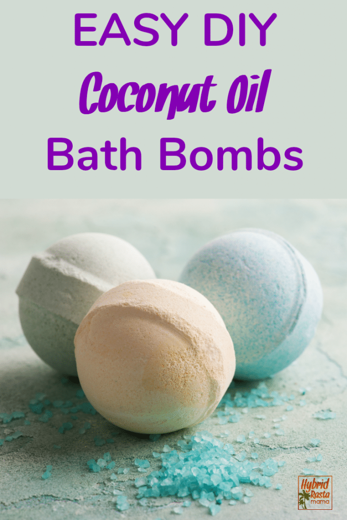 Three easy DIY coconut oil bath bombs on a light cement background with aqua colored bath salts sprinkled around