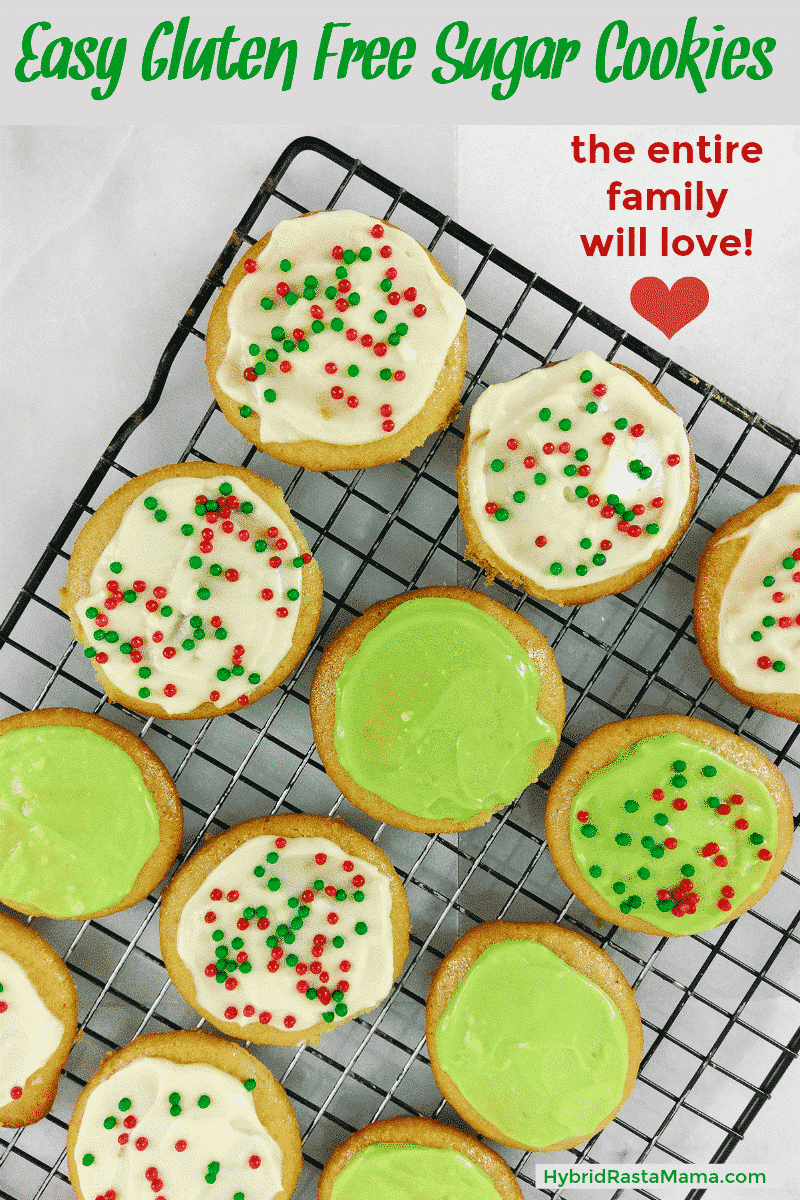 Gluten free sugar cookies on a wire cooling rack. They are frosted in white and green with christmas color round sprinkles.