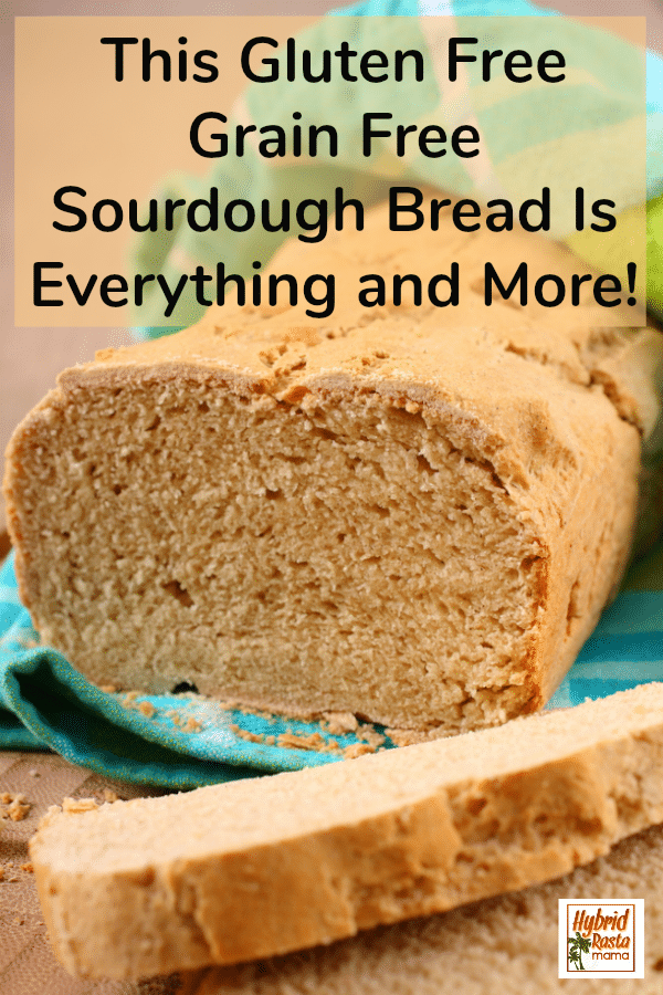 A sliced loaf of gluten free sourdough bread on a wooden cutting board
