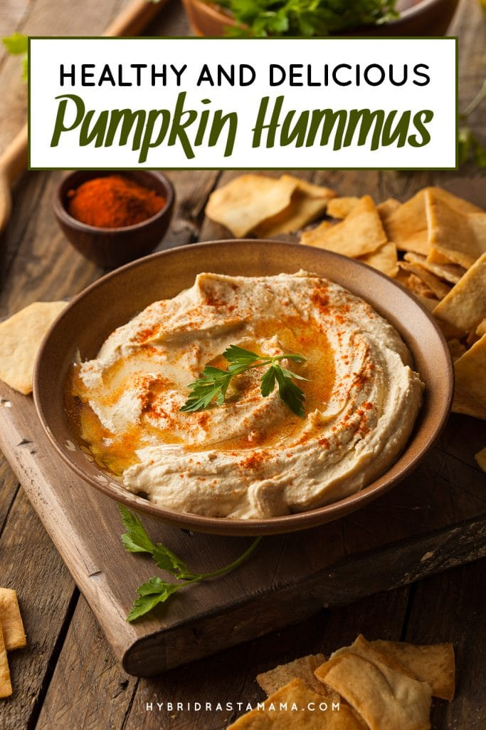 A large wooden bowl filled with seasonal pumpkin hummus