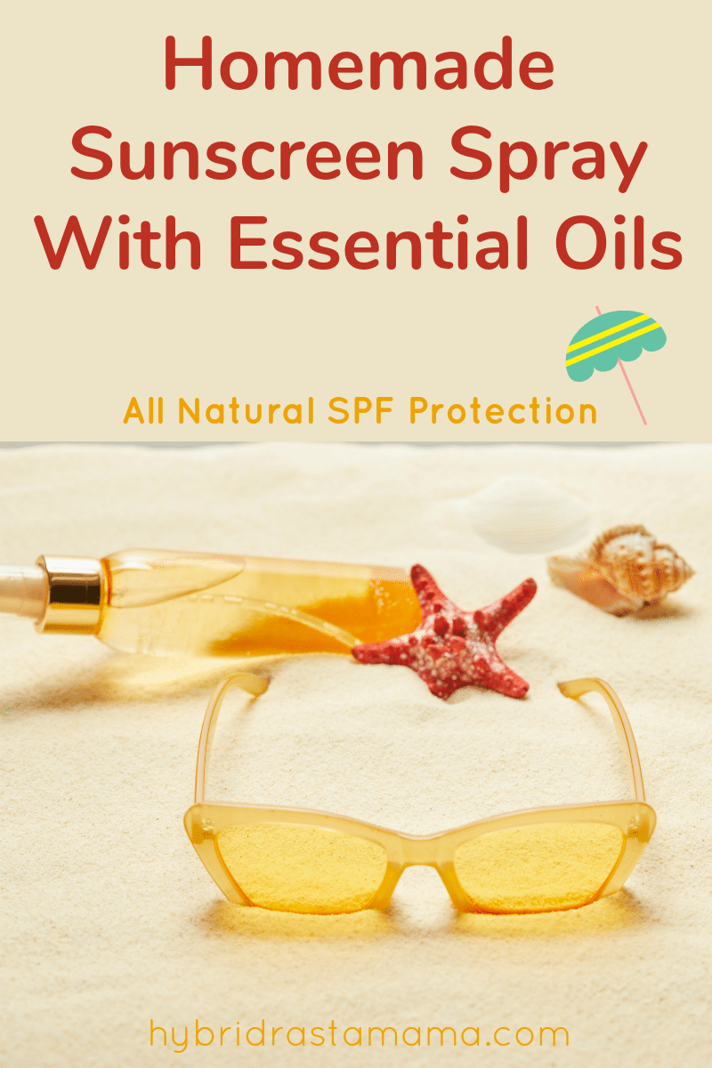 A bottle of natural sunscreen with essential oils lying sideways on the sand near a starfish
