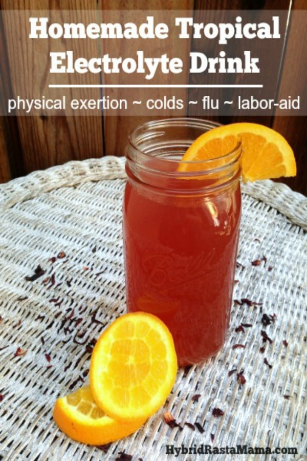 mason jar with tropical electrolyte drink and a wedge of orange