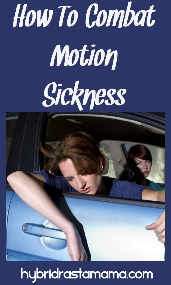 Teen with motion sickness hanging out the window of car with mom looking on