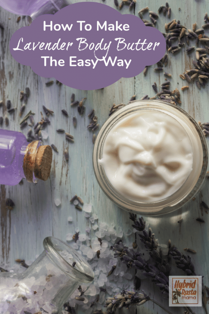 A small glass jar of lavender body butter surrounded by lavender sprigs and essential oils