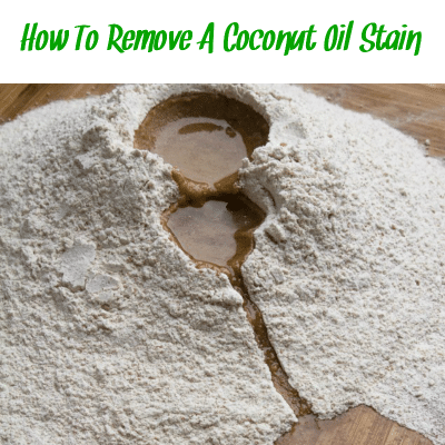 "Spilled coconut oil on a hardwood floor with the words ""how to remove a coconut oil stain."""