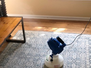 A mold fogger on the floor of a home being used for mold hygiene