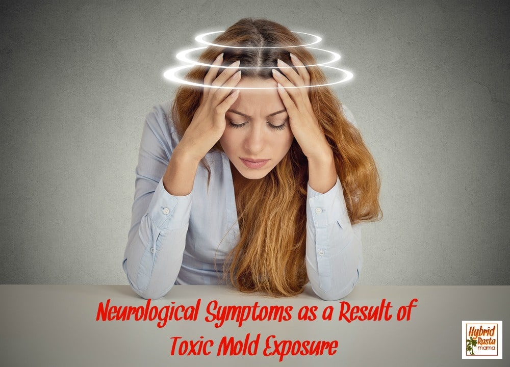 Woman holding her head and is dizzy due to neurological symptoms from mold exposure