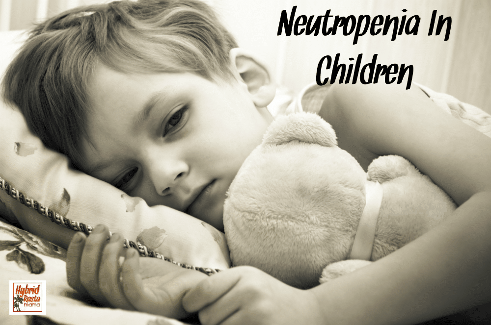 A sick little boy lying in bed with his teddy bear. He is neutropenia.