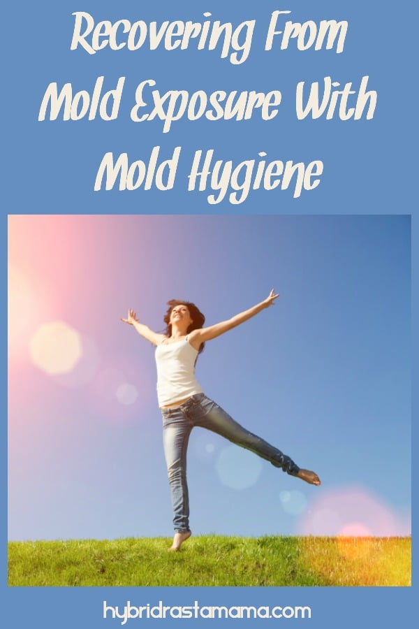 A vibrant woman in a grassy field. She has recovered from mold exposure with mold hygiene.
