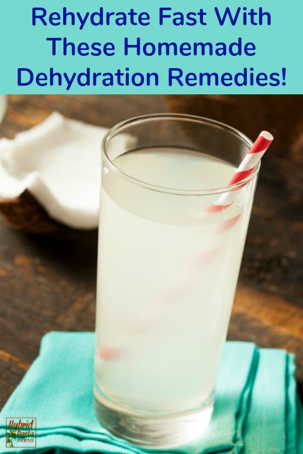 Homemade dehydration remedies in a glass on a teal napkin