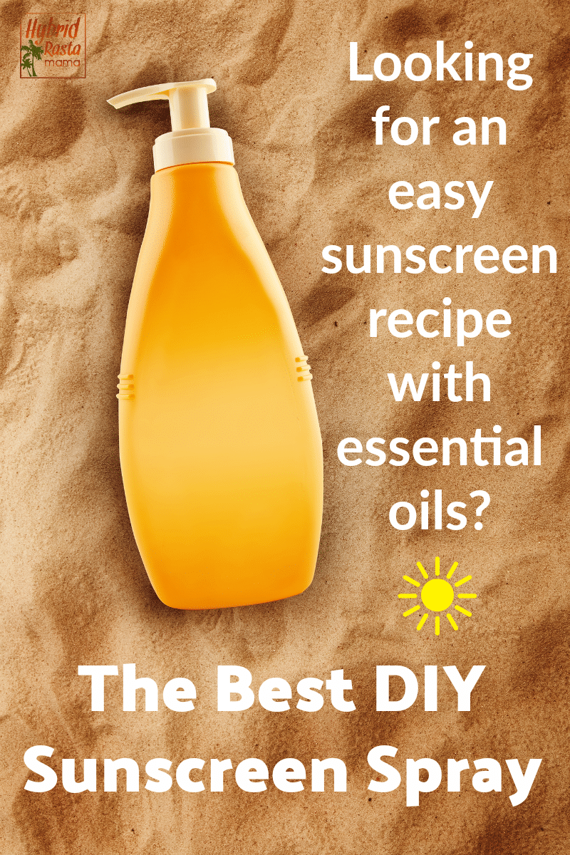 A bottle of natural sunscreen with essential oils lying sideways on the sand.