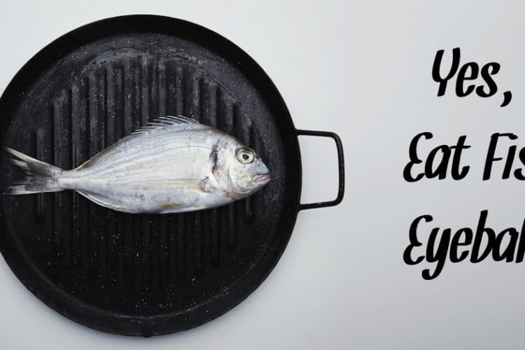 Presentation of fresh wild sea bream on grill pan ready to cook, isolated on side of white table