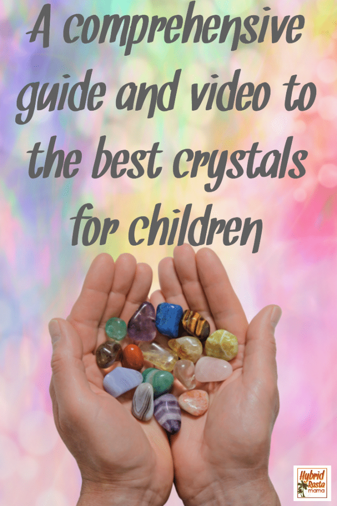 A whimsicle background with two hands holding various healing crystals for children and adults